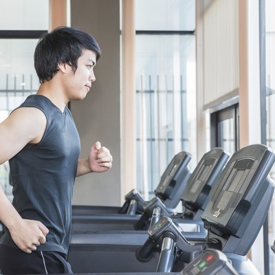 man at the gym doing exercise on  treadmill