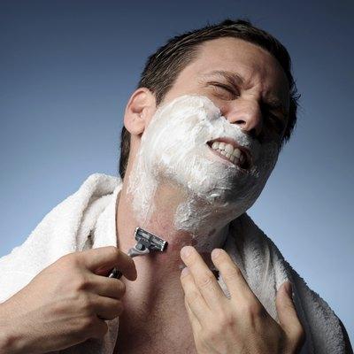 Man Shaving With Razor Burn