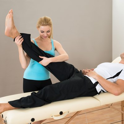 Female Instructor Helping Man For Exercising