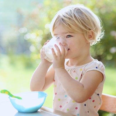 Little girl having breakfast indoors