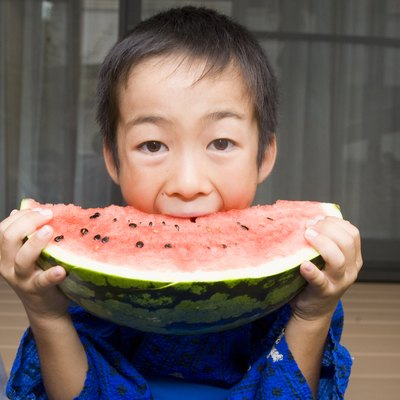 Boy Biting Watermelon