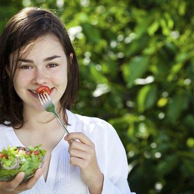 Girl eating vegetable salad