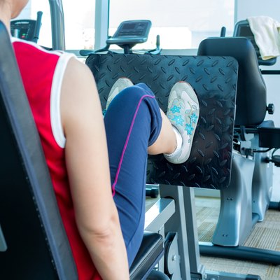 Woman exercising with machine in gym