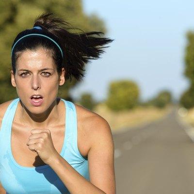 Sport woman running in road