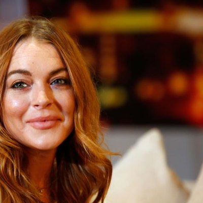 """LONDON, ENGLAND - SEPTEMBER 30: Lindsay Lohan performs during a photocall for """"Speed The Plow"""" at Playhouse Theatre on September 30, 2014, in London.  (Photo by Tim P. Whitby/Getty Images)"""