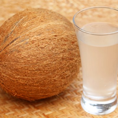 Fresh Coconut with water in a glass