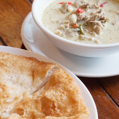 Thai food: green curry with coconut milk and fried Roti