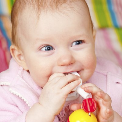 Infant with teething toy