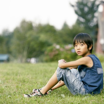 Japanese boy sitting, looking at camera