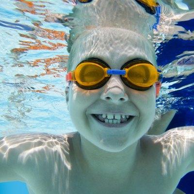 Smiling boy underwater