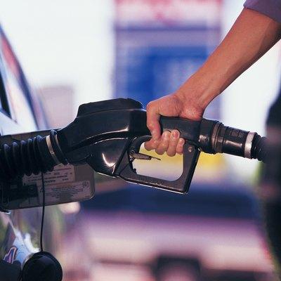Man pumping gasoline