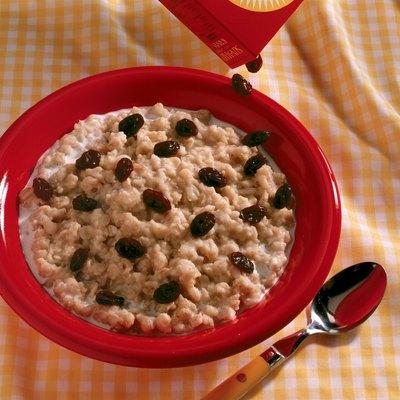 Raisins pouring over oatmeal