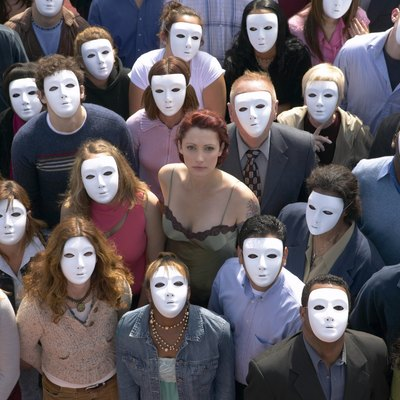 Woman Surrounded by a Crowd of People Wearing Masks