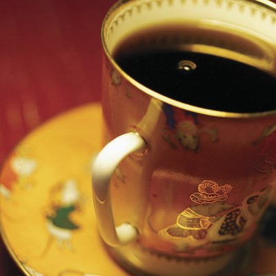 Black coffee in ornate coffee cup