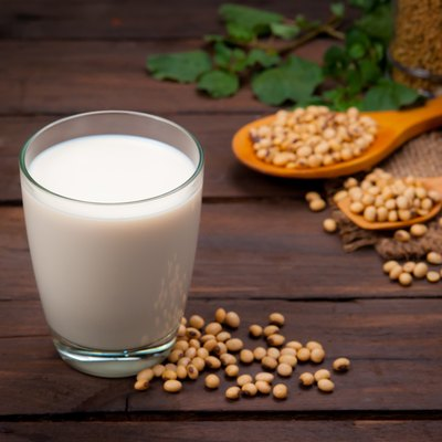 Soy milk with beans on wood