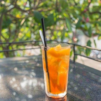 Enjoy a glass of Peach tea in sunny morning