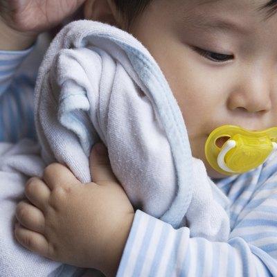 Baby Holding Blanket