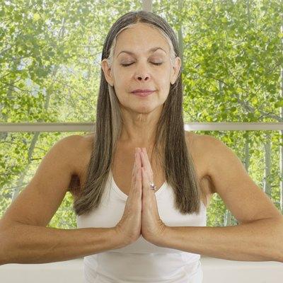 Asian woman practicing yoga