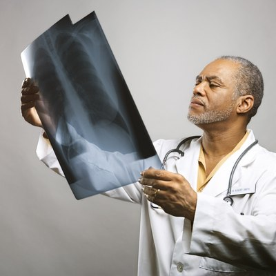 Healthcare worker looking at x-ray
