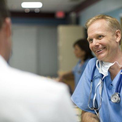 Doctors talking in hospital reception area