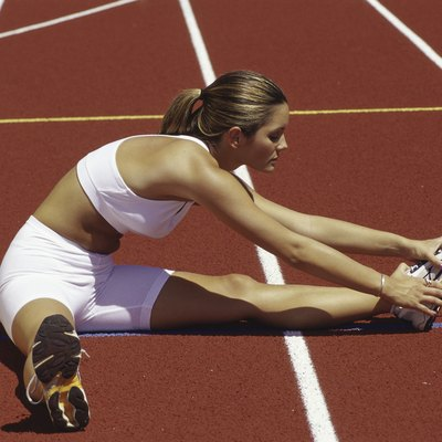Woman stretching on a running track