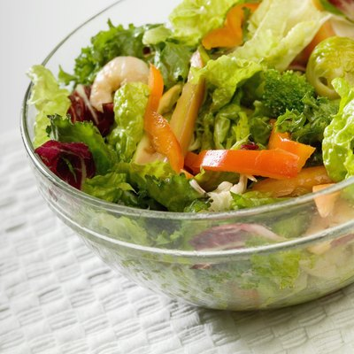 Bowl of salad with shrimp and vegetables, close-up, part of