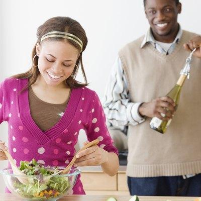 African couple preparing food