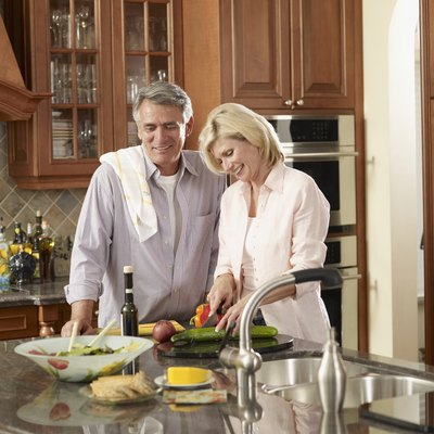 Multi-ethnic couple preparing food