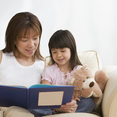 Asian mother and daughter reading