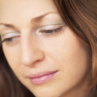 Close-up head shot of depressed woman