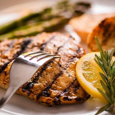 Chicken breast dinner on plate
