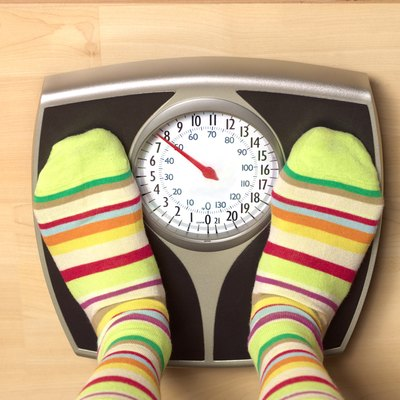 Dieting woman on bathroom scales