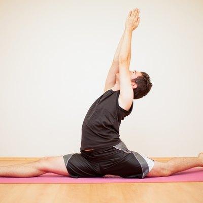 Young man doing a leg split