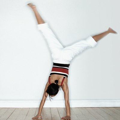 Woman doing cartwheel in studio