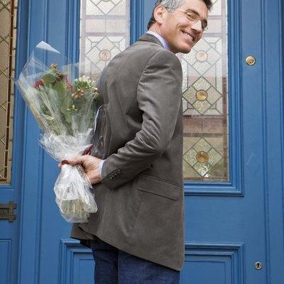 Man at door with bouquet