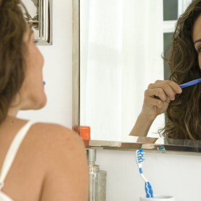 Mid adult woman brushing her teeth