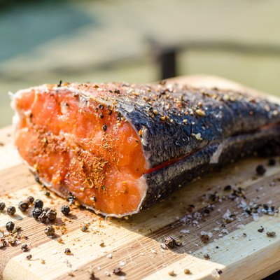 Prepared peace of fresh salmon fish with salt and pepper