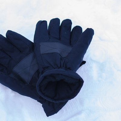Snow gloves in winter season with snow background