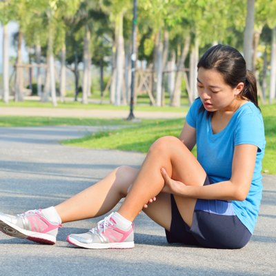 Woman in pain while running in park
