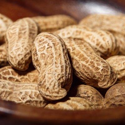 Peanuts in wooden dish closeup macro