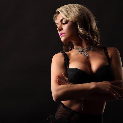 Bodybuilder woman studio isolated shot with big tits breast studio