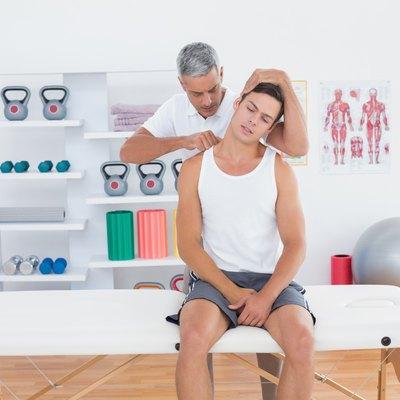 Doctor examining his patient neck