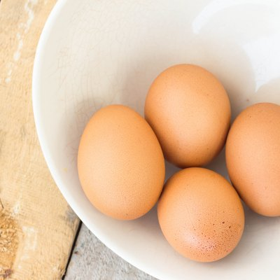 chicken eggs on towel and bowl