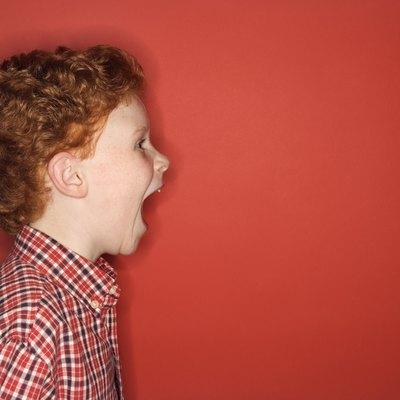 Studio shot of boy screaming