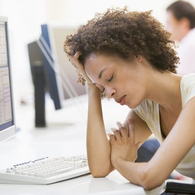 Woman in computer room sleeping