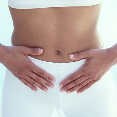 Woman with hands on abdomen