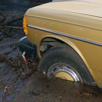 Shot of car hood stuck in deep mud