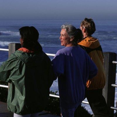 Three women walking along pier