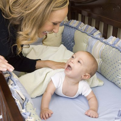 Mother talking to son in crib