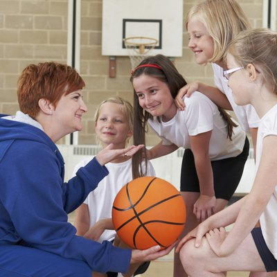 Teacher Giving Team Talk To School Basketball Team